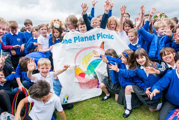 Eating and playing outside at our One Planet Picnic